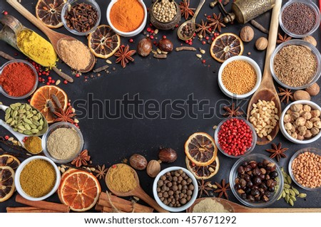 Composition of spices on a black background with a copy space - stock photo
