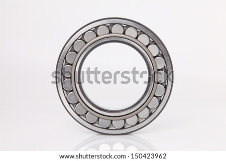 Composition of steel ball roller bearings in closeup on white background - stock photo