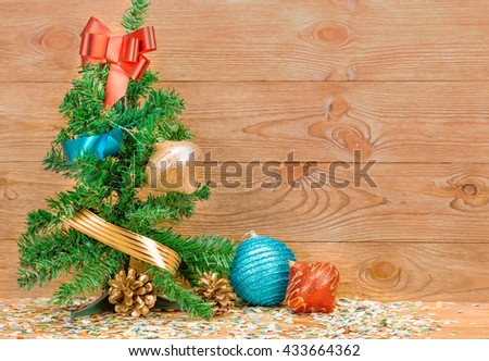Composition of the christmas decorations. It arrangement on the wooden background. - stock photo