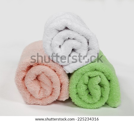 Composition of three rolled towels, isolated on white background - stock photo