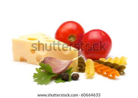Composition of: tomatoes, colorful fancy fusilli, spices, garlic, parsley. Close-up. Isolated on white background.