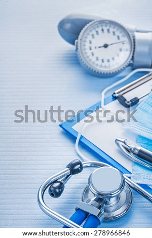 composition of tools blood pressure monitor stethoscope cipboard with sheet of paper pen medical concept  - stock photo