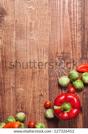 Composition of veggies on wooden table surface - stock photo