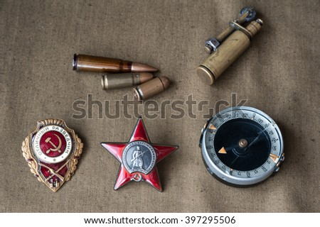 composition of Victory Day. orders, compass, lighter, live ammunition. 9 May. - stock photo