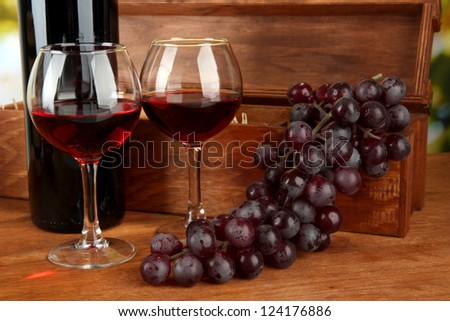 composition of wine,box and grapes on bright background - stock photo