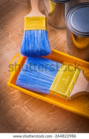 composition paintbrush on paint tray and cans construction concept  - stock photo