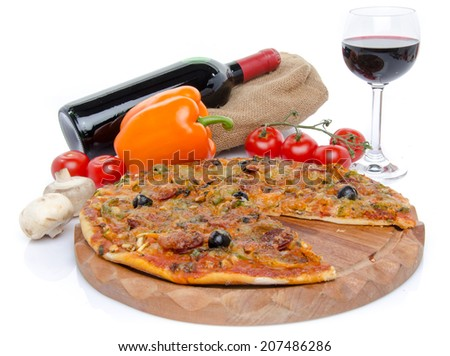 Composition with a pizza, some vegetables, a glass and a bottle of wine, isolated on white - stock photo