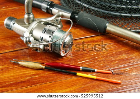 Composition with a spinning and fishing floats on wooden background