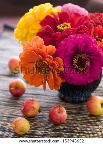Composition with an autumn apples and flowers, selective focus  - stock photo