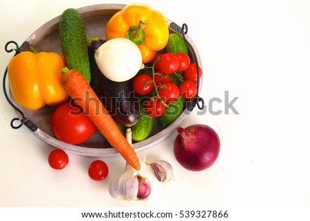 Composition with assorted raw organic vegetables on table