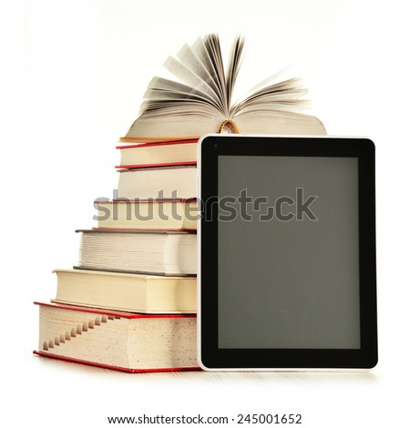 Composition with books and tablet computer isolated on white background - stock photo
