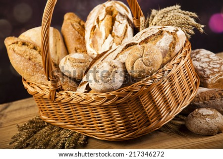Composition with bread and basket  - stock photo