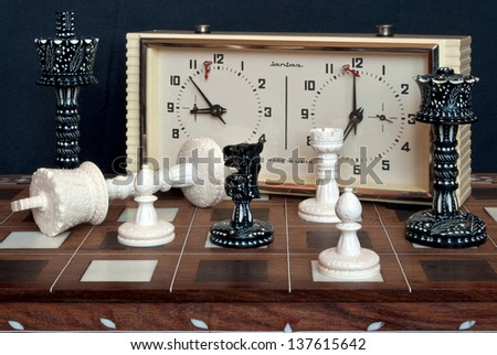 Composition with chess and chess clocks. After the game. - stock photo