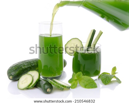 Composition with cucumber juice poured into a glass, isolated on white - stock photo