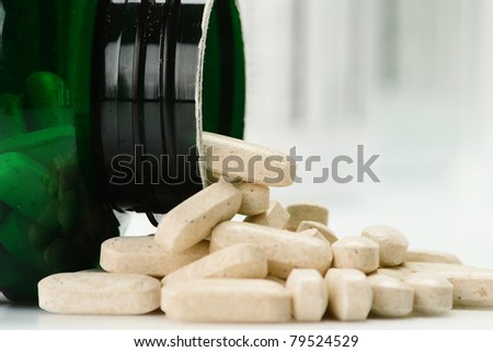 Composition with dietary supplement capsules and containers. Drug pills. - stock photo