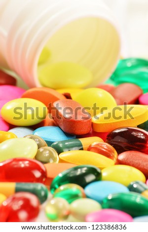 Composition with dietary supplement capsules and drug pills - stock photo
