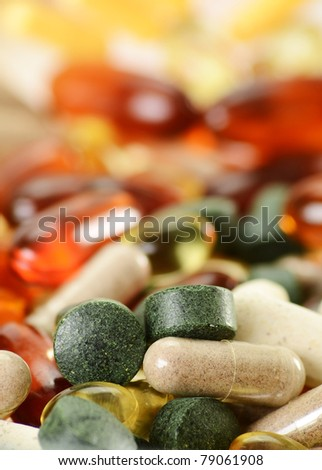 Composition with dietary supplement capsules and tablets - stock photo