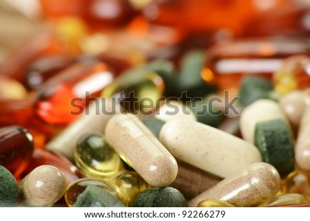 Composition with dietary supplement capsules and tablets. Variety of drug pills