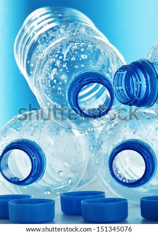 Composition with empty polycarbonate plastic bottles of mineral water - stock photo