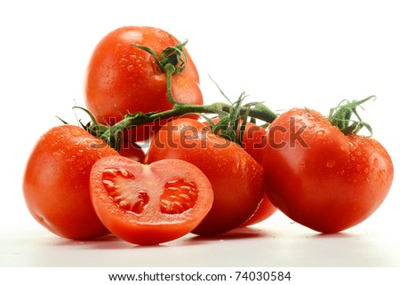 Composition with fresh tomatoes isolated on white background - stock photo