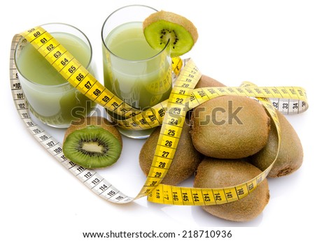 Composition with glasses of kiwi juice, fresh kiwis and a tape measure, isolated on white - stock photo