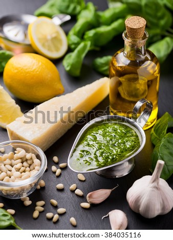 Composition with ingredients for sauce pesto preparing - stock photo