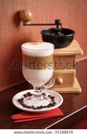 Composition with Latte and coffee-grinder