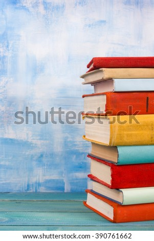 Composition with old vintage colorful hardback books, diary on w - stock photo