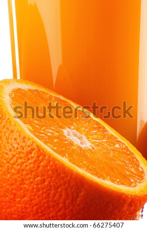 Composition with orange and glass of orange juice