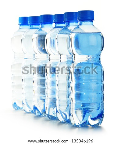 Composition with polycarbonate plastic bottles of mineral water - stock photo