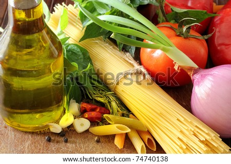 Composition with raw pasta,vegetables ,olive oil and herbs