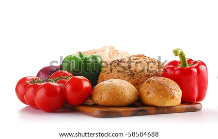Composition with raw vegetables and bread on breadboard - stock photo
