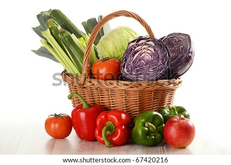 Composition with raw vegetables and wicker basket isolated on white background - stock photo