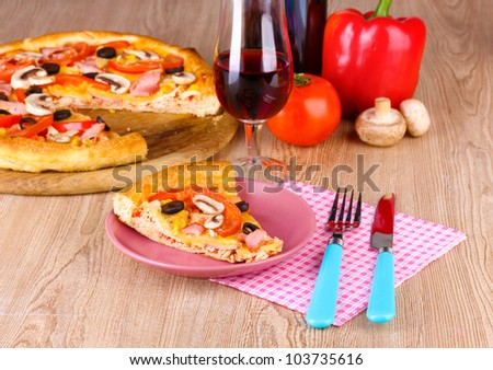 Composition with slice of pizza on plate close-up on wooden background
