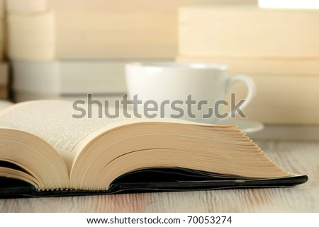 Composition with stack of books and cup of coffee - stock photo