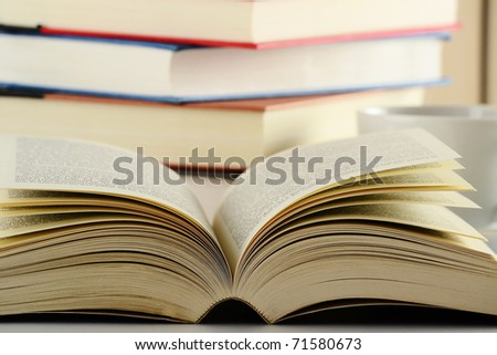 Composition with stack of books on table