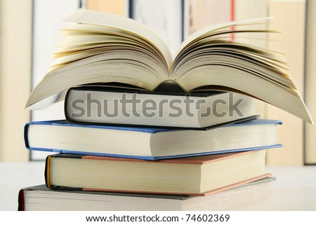 Composition with stack of books on the table - stock photo