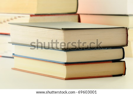 Composition with stacks of hardcover books