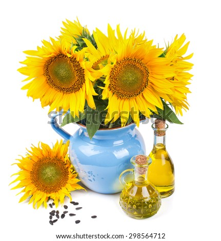 composition with sunflowers and sunflower oil isolated on white background - stock photo