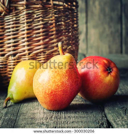 Composition with Three Pears on the Dark WoodenTtable - stock photo