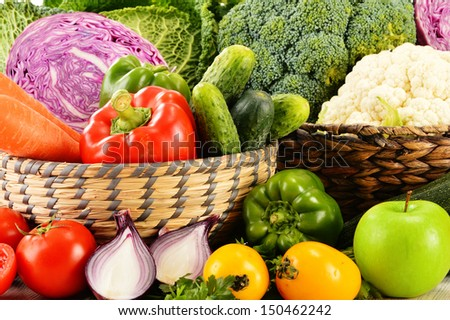 Composition with variety of fresh organic vegetables - stock photo