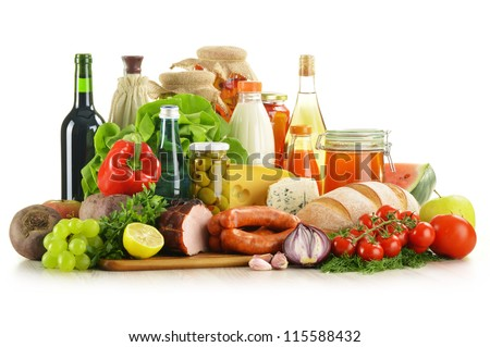 Composition with variety of grocery products including vegetables, fruits, meat, dairy and wine - stock photo