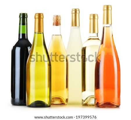 Composition with variety of wine bottles isolated on white - stock photo