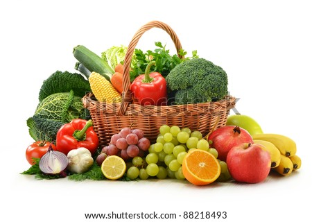 Composition with vegetables and fruits in wicker basket isolated on white - stock photo