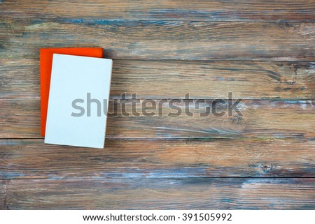 Composition with vintage old hardback books, diary on grunge wooden deck table background. Back to school. Copy Space. Education background - stock photo