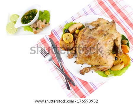 Composition with Whole roasted chicken with vegetables, color napkin, on plate, isolated on white
