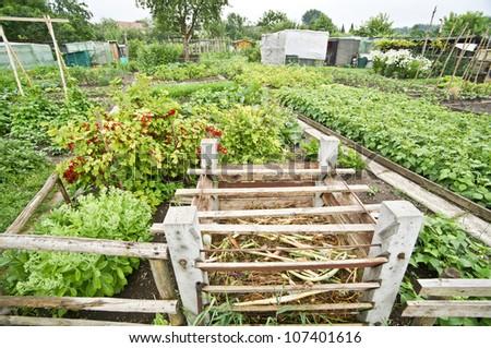 Compost bin in a vegetable garden - stock photo