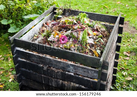 Compost bin in the garden - stock photo