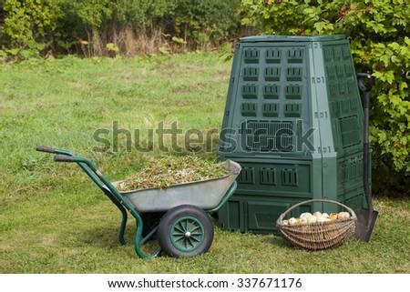 Compost bin, waste in a garden. - stock photo
