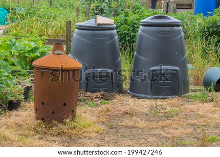 Compost bins and garden incinerator. - stock photo